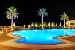 swimming pool in night illumination, halkidiki, greece - stock photo
