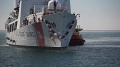 USCGC Boutwell Being towed or tugged into port 2 Stock Footage