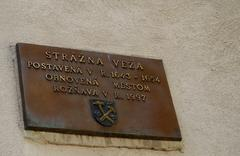 the descriptive plaque on the city tower, roznava, slovakia. - stock photo