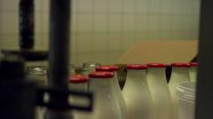 Adding empty bottles to the conveyor [Slomo] Stock Footage