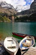Wooden boats at lake o'hara, yoho national park, canada Stock Photos