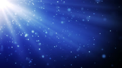Blue particles in light beams loopable background Stock Footage