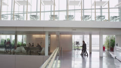 Diverse city business group in reception area of large modern corporate building Stock Footage
