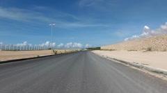 Driving along a paved road outside Mogadishu, Somalia Stock Footage