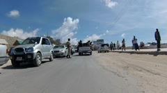 Somali Policeman Directs Traffic and Truck of Somali Soldiers Stock Footage