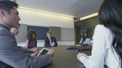 Diverse corporate business team in boardroom meeting in city office - stock footage