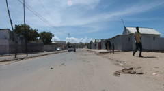 Tracking Through Streets of Mogadishu Following Armed Soldiers Stock Footage