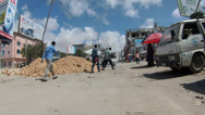 Stock Video Footage of Dodging Pedestrians and a 4-wheeler in Mogadishu, Somalia