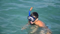 Young boy having summer fun swimming with mask Stock Footage