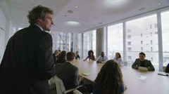 Corporate business team in boardroom meeting in London city office - stock footage