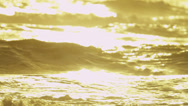 Stock Video Footage of Sunset Reflecting Gentle Rolling Ocean Waves