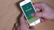 Stock Video Footage of 4K Playing Flappy Bird on an iPhone 5S 3986