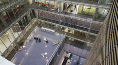 High angle view looking down on business people in large corporate building - stock footage