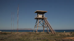 Derelict sentry tower US Air Force Base abandoned Gournes Crete Greece Stock Footage