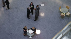 High angle view looking down on business people together in corporate building - stock footage