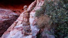 Mayan Serpent Statue in Front of Cave with Pan Action Stock Footage