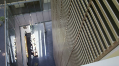 High angle view of reception area in large contemporary office building - stock footage
