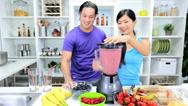 Ethnic Male Female Kitchen Blender Fresh Fruit Juice Stock Footage