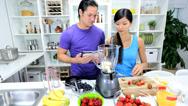 Ethnic Male Female Kitchen Blender Fresh Fruit Stock Footage