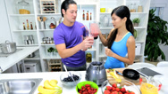 Ethnic Male Female Kitchen Blender Fresh Fruit Juice Stock Footage