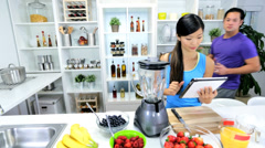 Ethnic Male Female Kitchen Blender Fresh Fruit - stock footage