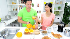 Young Asian Chinese Couple Breakfast Juice - stock footage