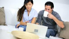 Worried Ethnic Couple Home Financial Stress Using Laptop Stock Footage