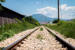 railroad track goes ahead - stock photo