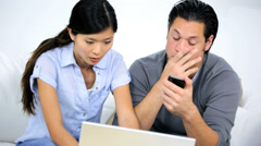 Worried Ethnic Couple Home Financial Stress Using Laptop - stock footage