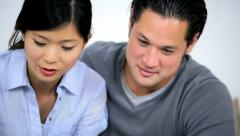 Portrait Relieved Young Ethnic Couple Successful Financial Planning Stock Footage