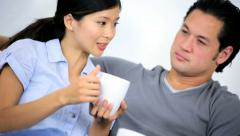 Happy Asian Chinese Couple Home Couch Mugs Hot Coffee - stock footage