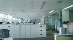 Interior view of office work stations in large contemporary city office building Stock Footage