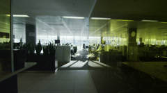 Interior view of office work stations in large contemporary city office building - stock footage