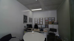 Interior view of empty meeting room & work stations in large modern city office Stock Footage