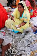 Stock Photo of indian woman selling bangels at sadar market, jodhpur, india