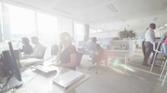 Attractive diverse business group working together in large modern city office.  - stock footage