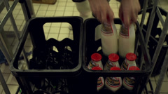 Filling a crate with glass bottles buttermilk Stock Footage