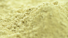Portion of ginger powder (loopable) Stock Footage