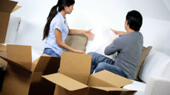 Young Ethnic Couple Unpacking Moving Cartons Stock Footage