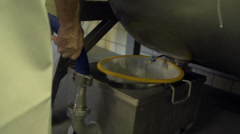 Filtering buttermilk Stock Footage
