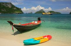 longtail boat at mae koh island, ang thong national marine park, thailand - stock photo