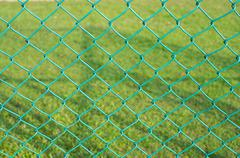 baluster steel with green grass background - stock photo