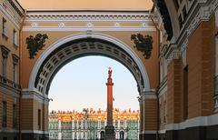 winter palace view through senate arch at dawn, st petersburg - stock photo
