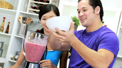 Young Ethnic Couple Using Blender Organic Fruit Drink Stock Footage