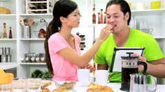 Ethnic Couple Kitchen Counter Breakfast Coffee Pastries - stock footage