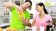Healthy Asian Chinese Couple Wireless Tablet Kitchen Breakfast Stock Footage