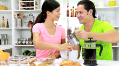 Young Ethnic Couple Preparing Breakfast Coffee Stock Footage