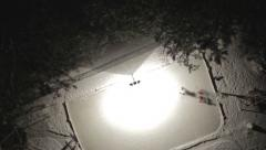 AERIAL - Ice hockey on homemade rink Stock Footage