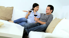 Asian Chinese Couple Drinking Red Wine Home Sofa Stock Footage