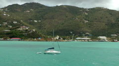 British Virgin Islands Tortola Road Town 061 a sailing boat with a dinghy Stock Footage